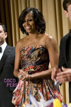 She looks gorgeous!!! This is the most fashionable FLOTUS since Jackie O!!
