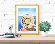 Great style in a stunning location is the essence of la dolce vita, or the sweet life. If you love the sweet life (and a great hat) then you need this print!  Details: Print features: Watercolor illustration of a women wearing a red striped shirt and pompom straw hat with la dolce vita written on i