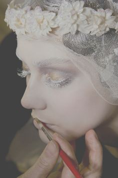 Ghostly John Galliano makeup.