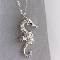 """Silver Seahorse Pendant Necklace Sparkling crystal accented seahorse on silver tone chain. Approximate 18"""" chain length. Seahorse pendant length, approximately 2"""". Lobster claw clasp. Fashion/costume jewelry. Not sterling silver. Brand new retail. No trades, no holding, no offsite/App transactions.    ❗️PRICE IS FIRM UNLESS BUNDLED❗️ Jewelry Necklaces"""