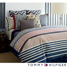 The Tommy Hilfiger Reading Room Striped Cotton Comforter Set features a vibrant set of red and blue stripes and reverses to a north/south stripe pattern. The machine washable set includes at least one sham.