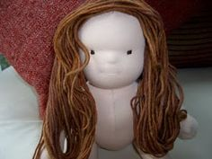 Good hair tutorial for creating full head coverage without crocheting a wig. Three layers of yarn stitched down at various points. Used Bamboletta's YouTube videos for styling buns. Ashtabeulah: Finishing your doll Section 1- Hair prep and supplies