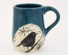 Woodcut-style bird is hand-etched on this handmade mug by Patricia Griffin in Cambria, Ca.