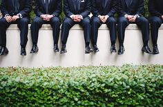 Groomsmen! on the stone wall out front