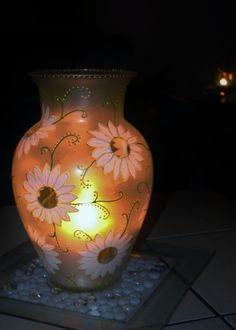 You know all those glass vases that you collect through the years from birthday, anniversary gifts...why not paint them and drop a candle in it! Turns out beautiful.