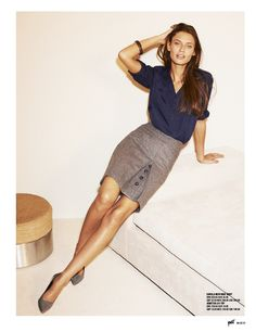 navy blouse and grey front button skirt