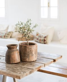San Giorgio, Mykonos, white walls, wood table, pottery / Garance Doré