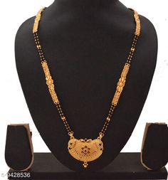 Mangalsutras RADHEKRISHNA golden color alloy material long fold over head 24 inch black and golden combination bead chain mangalsutra  Base Metal: Alloy Plating: Gold Plated Stone Type: Artificial Stones Sizing: Non-Adjustable Type: Big pendant mangalsutra Multipack: 1 Sizes:Free Size (Length Size: 24 in) Country of Origin: India Sizes Available: Free Size   Catalog Rating: ★4 (440)  Catalog Name: Elite Colorful Mangalsutras CatalogID_1655873 C77-SC1097 Code: 293-9428536-999