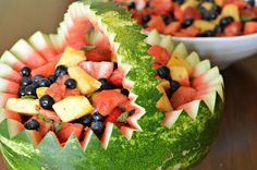 Spring fruit salad for a party served in a watermelon bowl. Easy to do and makes a great presentation.
