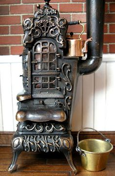 prev. pinner: My friend on the farm in Indiana lived in a lovely old brick house, with great fireplaces, and beautiful big chapel shaped windows. One day she showed me an old wood stove just like this,. It was in pieces and she discovered it in a shed.  We loved it...but didn't 't know where either of us could use it.