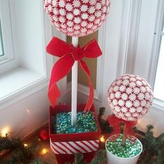 """10""""  STYROFOAM™ Brand Foam sphere  6"""" STYROFOAM™ Brand Foam cube  Pot or container for the base  Peppermint candies, about 4 1/2 11-oz bags  Red duct tape  1"""" dowel  Decorative accents and ribbon as desired"""