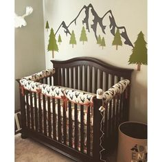 An adorable woodsy nursery featuring our Buck Forest in Night Woodland Crib Bedding!