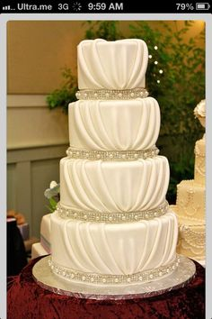 Wedding cake. I like how it looks like material is draped down the tears of the cake