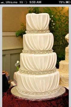 Wedding cake. I like how it looks like material is draped down the tears of the cake