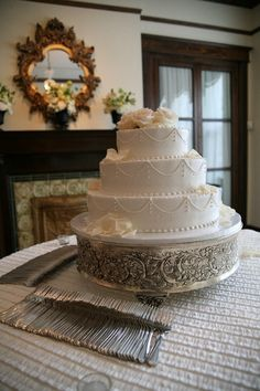 Nashville Garden Wedding Venue | CJ's Off the Square | Ivory Swag Wedding Cakes - Photo: Eyeris Photography