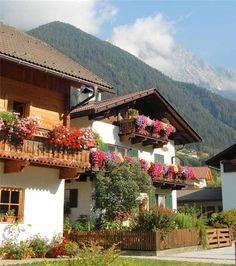 swiss chalet with flowers on balconies