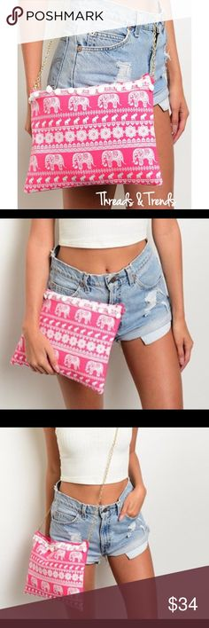 "Elephant Print Clutch/Bag Adorable and right on trend. Pink and white Elephant print Crossbody/clutch shoulder bag. Featuring Pom Pom detail, zipper closure and gold chain strap. Width 13"" / Length 10"" / Strap drop 27"" Neon Threads & Trends Bags"