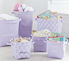 Lavender Canvas Storage #pbkids combination of lavender and pink storage in bookcase.