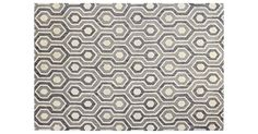 This loop-and-cut pile, hand-tufted rug offers gorgeous graphic impact with a sophisticated palette and motif. A rug pad is recommended to keep this foundation securely in place.