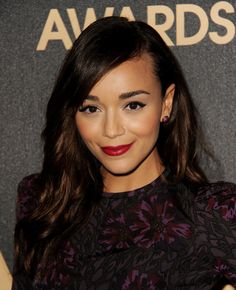 Ashley Madekwe: Sometimes sticking to the classics is a no-fail way to go. Actress Ashley Madekwe went for a timeless red lipstick paired with a simple liquid liner look. It's a great way to get dressed up without going overboard.   As for your hair? Create a dramatic side part that instantly glamorizes all hairstyles — long or short.