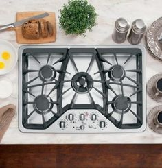 The GE Cafe Built-In Gas Cooktop features up to BTU's of cooking power from its five burners. Child lockout, LED lit knobs and a stainless steel cooktop aid in safety and efficiency.