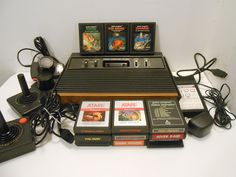 """1980s """"Good Condition"""" Sunnyvale Atari CX-2600A 4 Switch """"Woody"""" with Cords, Plugs, Controllers, a Star Raiders Video Touch Pad and 12 Games by hollister54 on Etsy https://www.etsy.com/listing/215811320/1980s-good-condition-sunnyvale-atari-cx"""