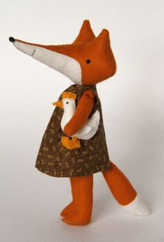 Mini Eida is just 18cm (7inches) tall. Needs assistance with standing up on her own.Eida can sit, move her little arms and legs.Ms fox comes with 3 dresses, felt coat, knitted scarf  Bigger fox Eida