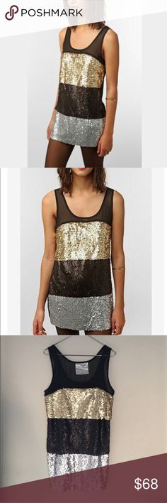 Urban Outfitters Upson Downes Sequin Dress Size L Beautiful multicolor Metallic Sequin tank dress by Urban Outfitters Upson Downes. Size Large. Excellent preowned condition. Urban Outfitters Dresses