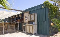 EAT @ CONTAINER The marina area being developed near San Jose del Cabo, Mexico, has a fun and quirky restaurant made out of a shipping container. Relax on the beach by the harbor, or walk through the cactus garden in the marina Pop Up Restaurant, Outdoor Restaurant, Restaurant Design, Container Home Designs, Container Shop, Shipping Container Restaurant, Shipping Containers, Deco Cafe, Sea Containers