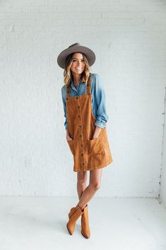 DETAILS: - Corduroy mustard dress overalls - Model is wearing a small