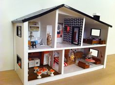 Hip dyi dollhouse with cool wall art. Better than any cheesy pre-made dollhouses sold in stores.