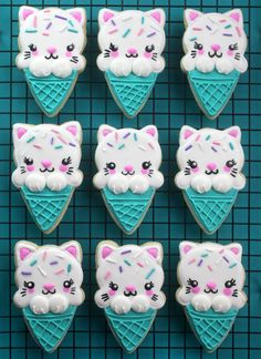 I'm super in love with these ice cream turned kitty cat cone sugar cookies. They are all kinds of adorable and pretty easy to decorate. I used this ice cream cone cookie cutter from Sweet Sugarbelle' Kawaii Cookies, Cat Cookies, Cupcake Cookies, Macarons, Biscuits, Bakerella, Sugar Cookie Dough, Summer Cookies, Cute Desserts