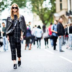 Matching separates are topped off a fall staple leather jacket. // #StreetStyle #LFW
