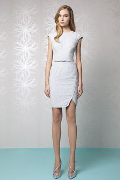Short Chinese style Silver dress in Silk Crepe covered with Lace, featuring cap sleeves and a belted waist.