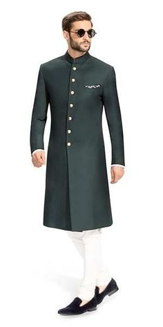 Gurhkan Racing Green This Racing Green Achkan is distinguished and elegant. It is made using fabric from Vitale Barberis Canonico. Featuring buttons that are cut from solid brass, rough buffed and plated in 24 carat gold. Indian Formal Wear, Mens Indian Wear, Indian Groom Wear, Nigerian Men Fashion, Indian Men Fashion, Mens Fashion Suits, Wedding Dresses Men Indian, Wedding Dress Men, Men Wedding Fashion