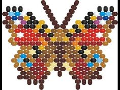 Weaving a peyote stitch Butterfly Inachis Io. Beading Projects, Beading Tutorials, Beading Patterns Free, Bead Patterns, Beading Needles, Beaded Cross, Peyote Stitch, Peyote Beading, Butterfly Pattern