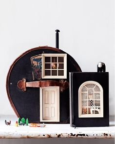charmed by this DIY transforming a vintage hat box found on Etsy into an adorable mini dollhouse.