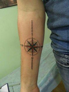 Red compass tattoo