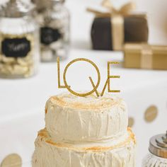 art deco style 'love' wedding cake topper by pea green boat | notonthehighstreet.com