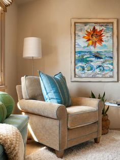 Traditional Twist  -  Folk art inspired by sea and sun brings aqua and orange into this traditional living space designed by Debra Lynn Henno.