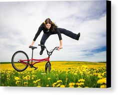 Bmx Flatland in spring Canvas Print for sale. Monika Hinz, one of the best female BMX Flatland riders, doing a trick on her red bike. Spring has sprung - Moni is jumping in a green spring meadow with beautiful yellow flowers. The image gets printed on one of our premium canvases and then stretched on a wooden frame, click through and check out your options. 30 days money back guarantee. Matthias Hauser - Art for your Home Decor and Interior Design.