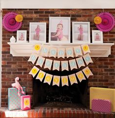 pink first birthday fireplace mantle decor