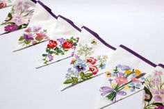 Fabric flag bunting handmade from embroidered tablecloths.