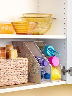Keep water bottles within reach and in view by stacking them in magazine files. Rest the inexpensive organizers on their backs for quick grab-and-go access./- LOVE the magazine holders for water bottle storage!