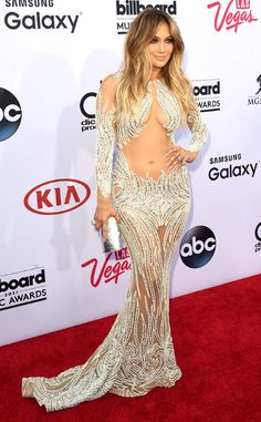Signature Look? from Jennifer Lopez's Best Looks  J.Lo shows plenty of skin (and her rock-hard physique) in a sexy Charbel Zoe Couture gown at the 2015 Billboard Music Awards.