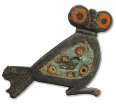Roman owl brooch, Denmark  Danish archaeologists investigating the settlement of Lavegaard on the island of Bornholm have uncovered an unusual and exquisite owl-shaped fibula. The 1.5-by-1.5-inch Roman brooch, which dates to the first through third centuries A.D., was discovered by metal detectorists working with the Bornholm Museum. The bronze owl is inlaid with enamel disks and colored glass, which were used to create the enormous orange-and-black eyes.