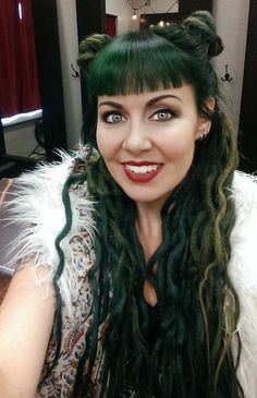 We're here to put green hair on the radar because we think it looks dang cute. In need of some emerald dreadlock supplies? Get the look at doctoredlocks.com :)