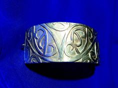 Silver precious metal clay cuff with hand carved Maori pattern.