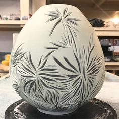 Day 2 carving this large vase! It's layered in turquoise and black! My patterns are completely spontaneous! I'm loving the result so far!…