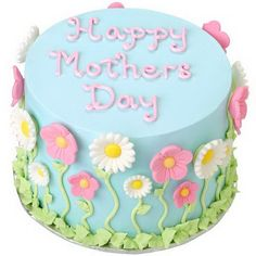 Beautiful wildflowers meander up the sides of this lovely floral cake made especially for Mother's Day. Our Daisies and Pink Poises Icing Decorations add a beautiful, easy accent to the sides. - can easily adapt to a birthday cake Bolo Floral, Floral Cake, Pretty Cakes, Cute Cakes, Mothers Day Cake Image, Fondant Cakes, Cupcake Cakes, Wilton Cakes, Mothers Day Cakes Designs